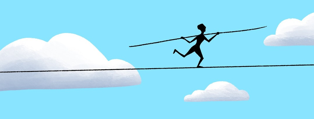 person balancing on a tightrope