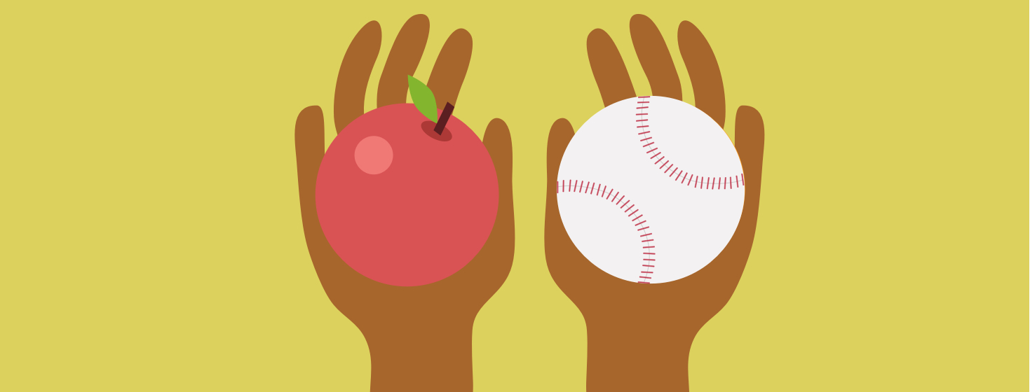 Two hands comparing a baseball and an apple