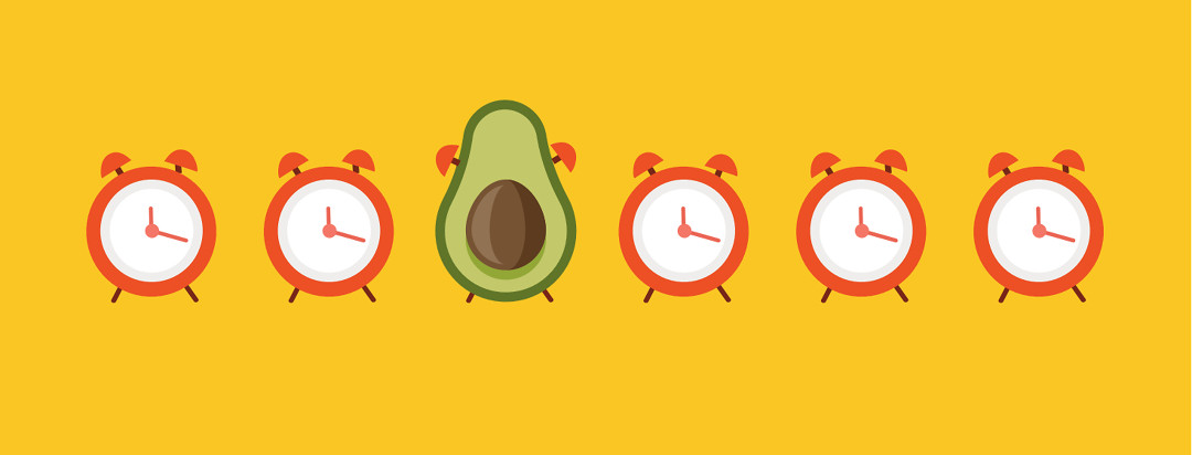 6 alarm clocks with one in the shape of an avocado.