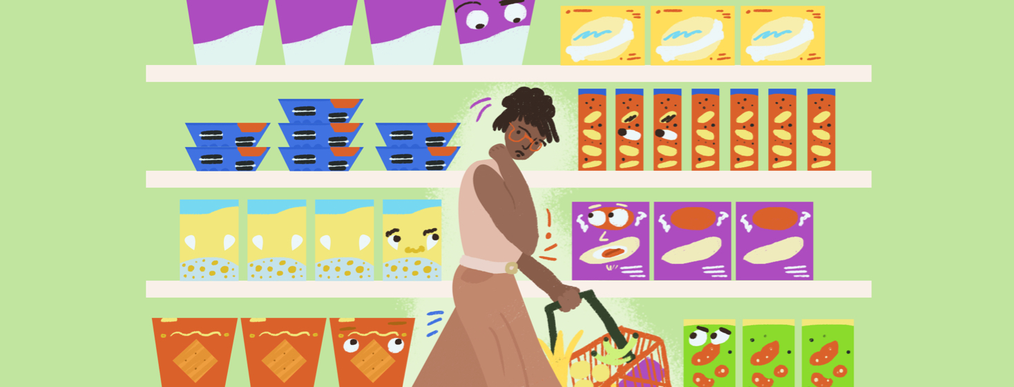 Woman holding a grocery basket is in the middle of an aisle of snack foods. Some of the boxes of treats have eyes that are staring at her.