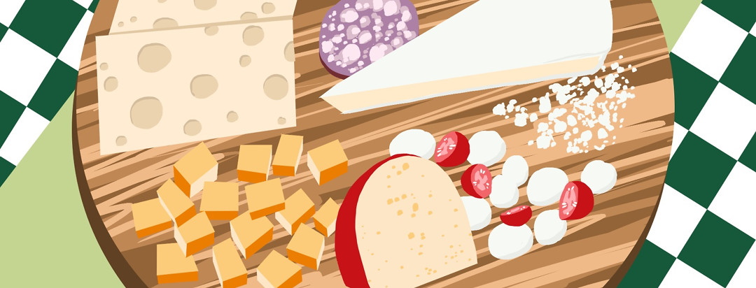 A plate of Swiss, mozzarella, tomato, salami, and more cheeses.