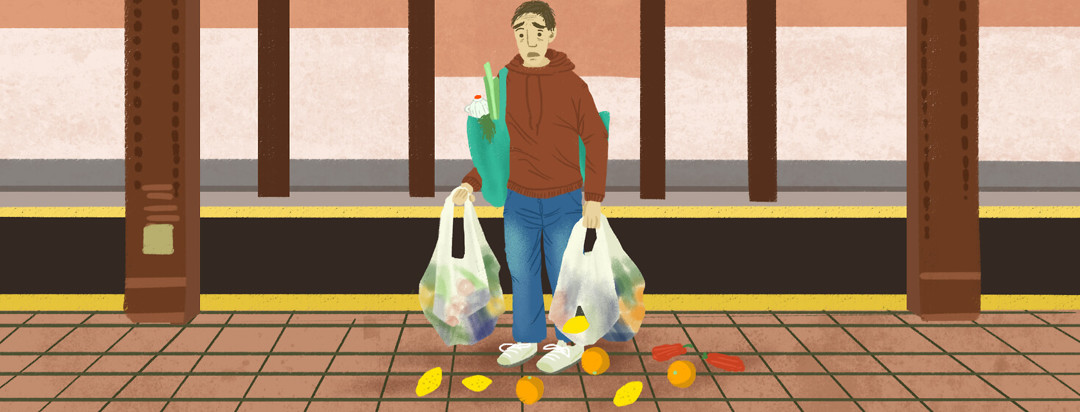 A person on the subway carries so many groceries on their own that a bag rips, letting loose a bunch of stray fruit.