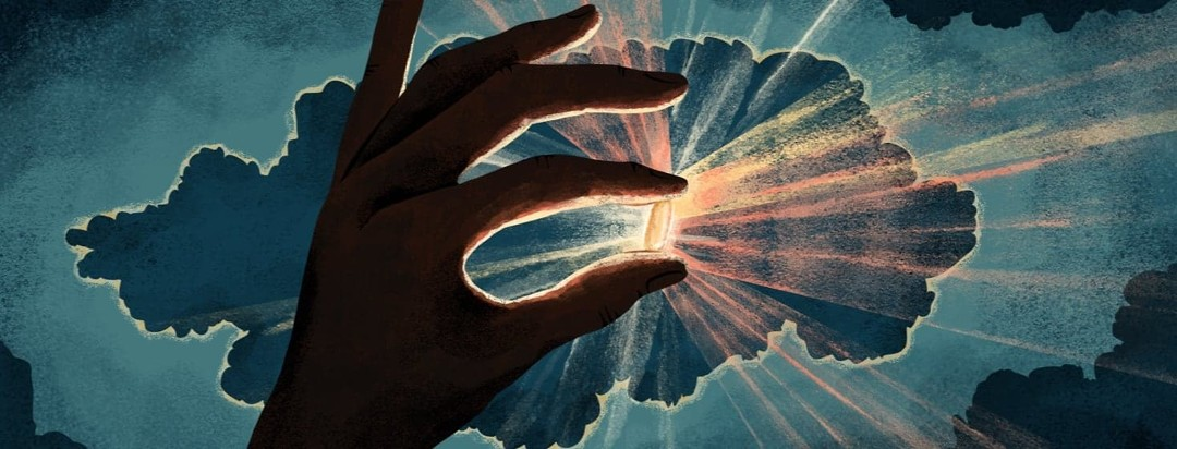 A hand in shadow handles up a pill that is illuminated from behind, emitting rays of light. This is set against a dark sky with a cloud also somewhat illuminated from behind.