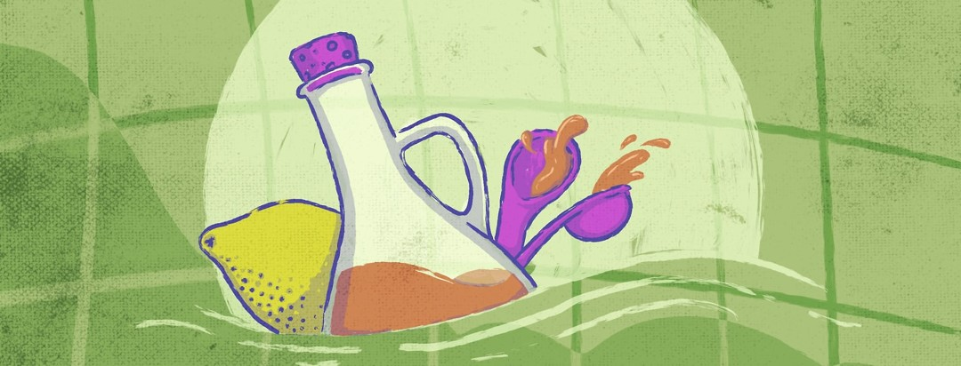 vinegar, a lemon and spoons with vinegar in it with a graph backdrop