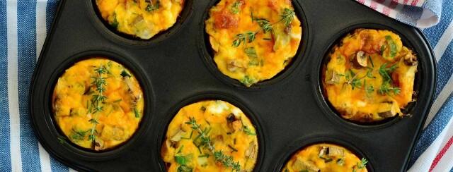Egg-Mushroom Muffins in a black muffin tin.