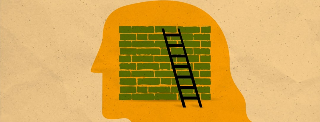 a ladder leaning against a brick wall in a head