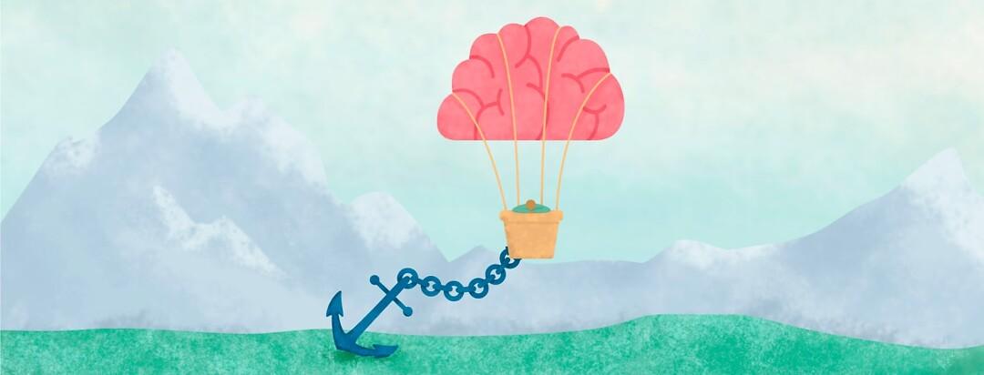 a hot air balloon shaped like a brain and an anchor