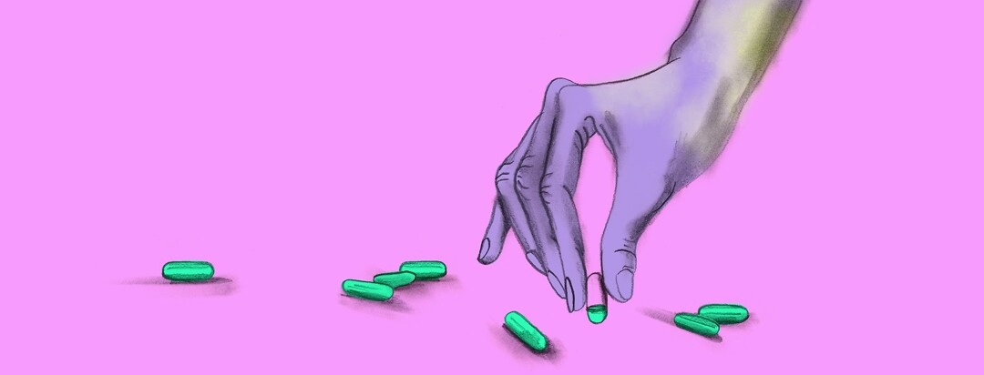 a hand picks up a vitamin pill that is only 25% full to imply a vitamin deficiency