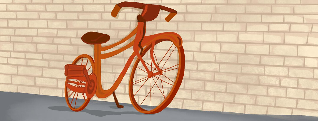 a bicycle leaning against a wall