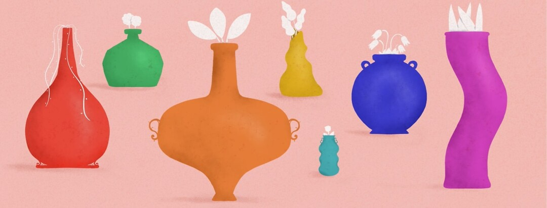 Vases of different shapes and sizes holding flowers